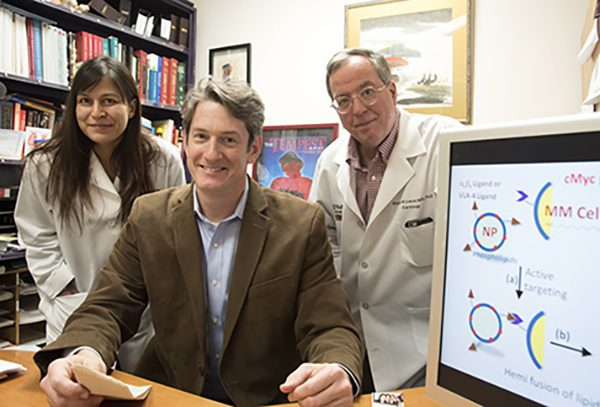 Researchers at Washington University School of Medicine in St. Louis have developed a nanotherapy that is effective in treating mice with multiple myeloma, a cancer of bone marrow immune cells. From left are first author Deepti Sood Gupta, PhD, and co-senior authors Michael H. Tomasson, MD, and Gregory M. Lanza, MD, PhD. (Photo: Robert Boston)