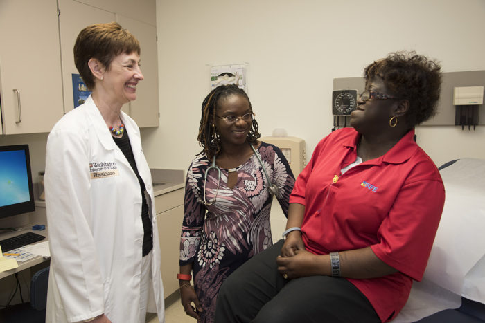Jean Bierut, MD, and Foluso Ademuyiwa, MD, with patient