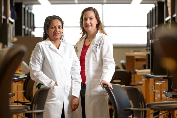 Radiation oncologist Julie Schwarz, MD, PhD, and staff scientist Ramachandran Rashmi, PhD