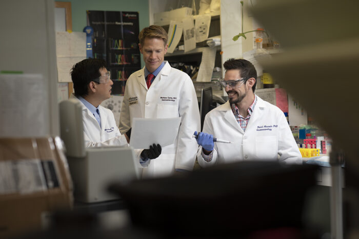 (From left) Baosheng Chen, PhD, Matthew Ciorba, MD, David Alvarado, PhD, and other members of Ciorba's lab have identified a way to make radiation therapy for colorectal cancer more effective by inhibiting a protein found in cancer cells in the gut. PHOTO BY MATT MILLER/WASHINGTON UNIVERSITY SCHOOL OF MEDICINE