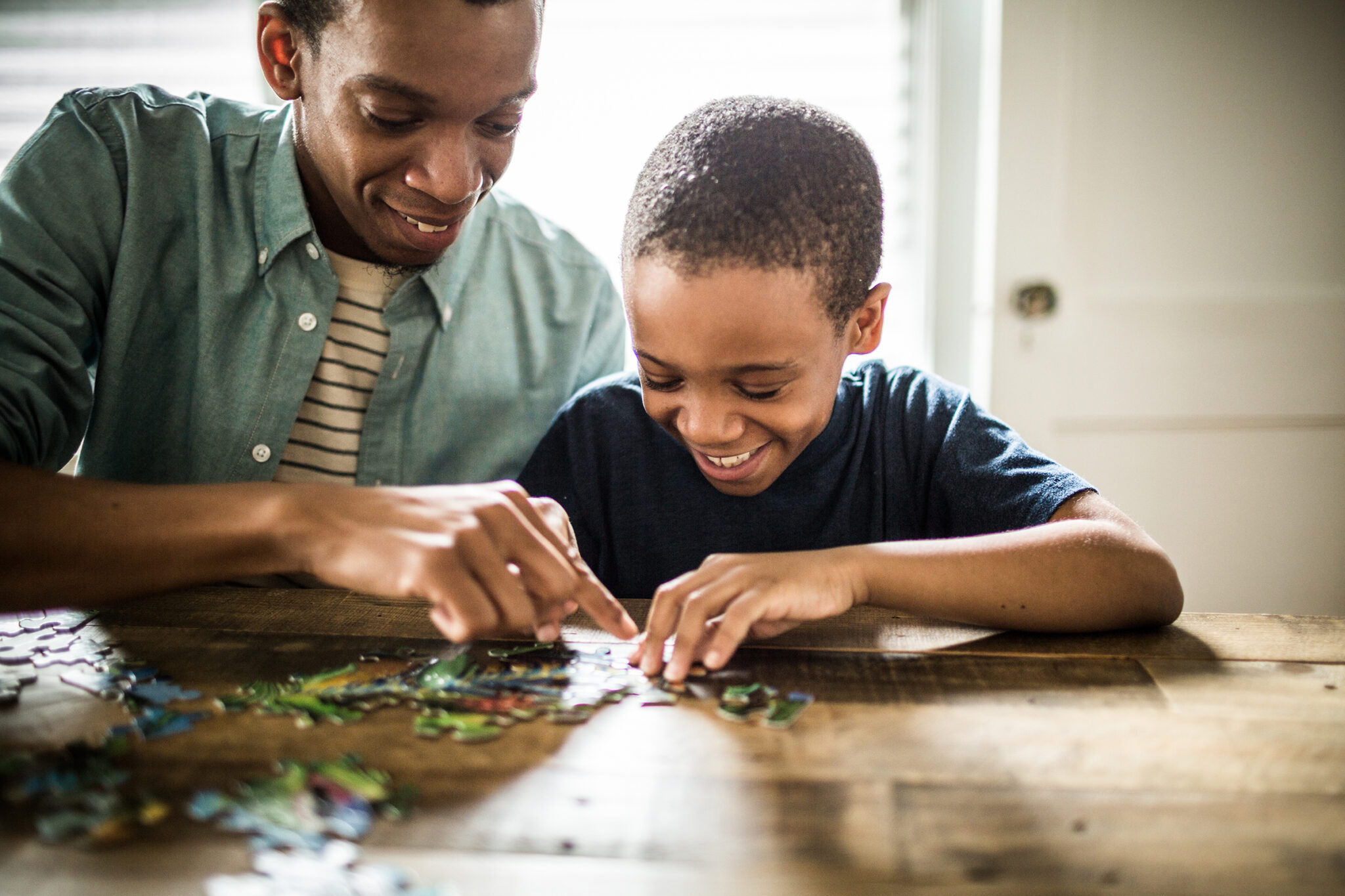 Father And Son Doing Puzzle